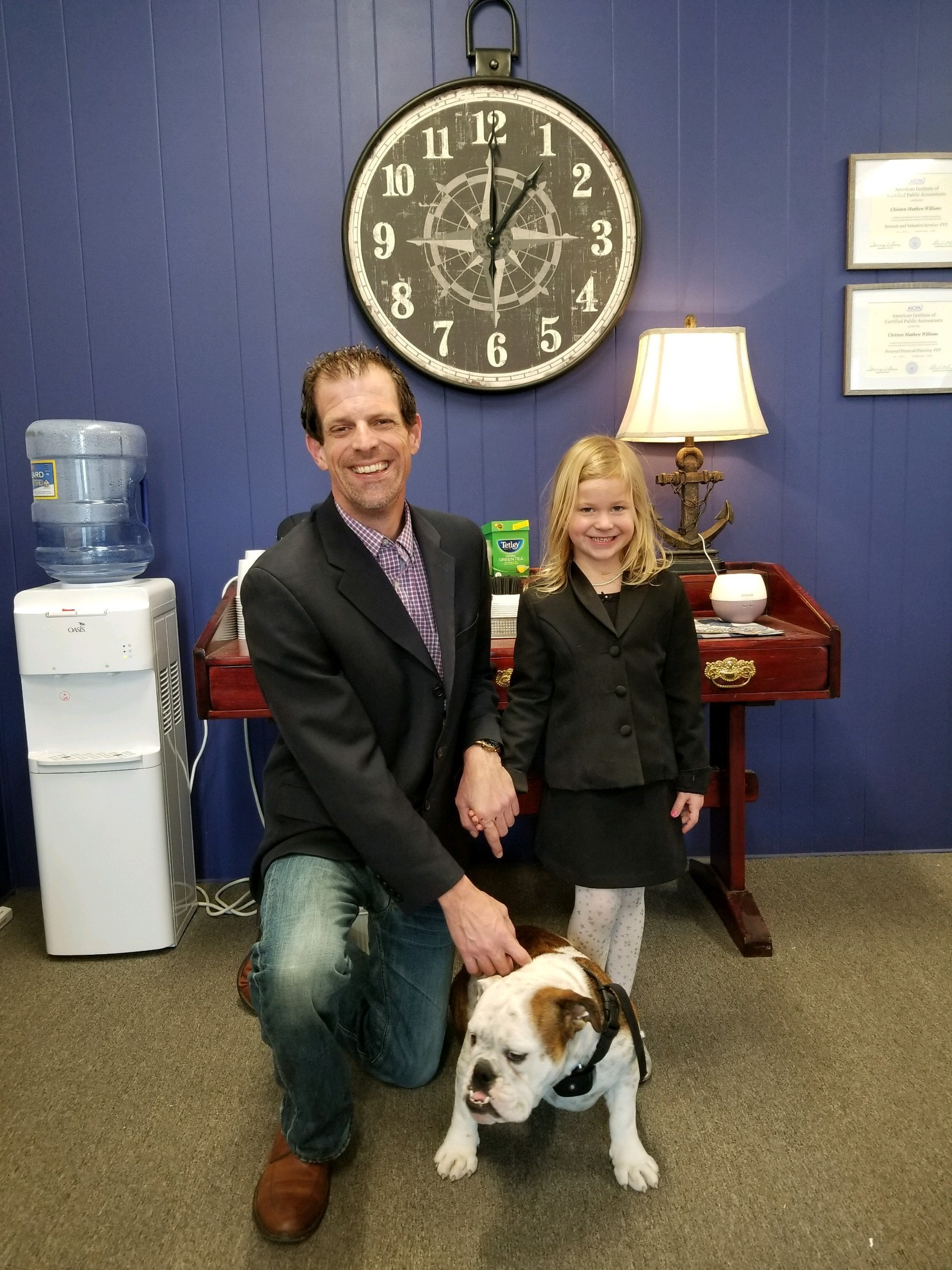 Chris Williams and daughter with bulldog